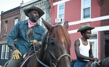 The title of director Ricky Staub's debut feature film, Concrete Cowboy,seems like an oxymoron. The mental image that conjures up every time we hear the word cowboy hardly ever involves an urban setting, and Hollywood has done its share to reinforce those notions. The film doesn necessarily urge you to give them up. Instead